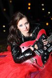 Guitar player girl in the night Royalty Free Stock Image