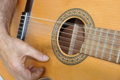 Guitar player hand. Guitar player close up on hand and strings Royalty Free Stock Photo