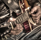 Guitar player in hdr Stock Images