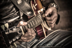 Guitar player in hdr Royalty Free Stock Image