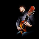 Guitar player isolated on black Royalty Free Stock Photo