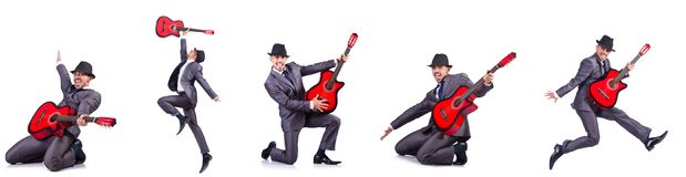 The guitar player isolated on the white Royalty Free Stock Photography