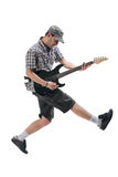 Guitar player jumping in midair. Isolated against white background stock photo