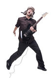 Guitar player jumping in midair. Isolated against white background stock photography