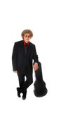Guitar Player leaning on case. Guitar Player in a suit leans on a guitar case Royalty Free Stock Photography