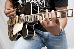 Guitar Player. Male strumming on a guitar Royalty Free Stock Photos