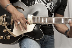 Guitar Player. Male strumming on a guitar Royalty Free Stock Image