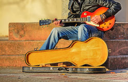 Guitar player with open guitar case Stock Photo