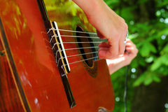 Guitar player. A guitar player on outdoors stock image