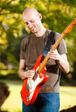Guitar Player in the park Royalty Free Stock Image