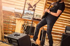 Guitar player performing on stage. Stock Photos