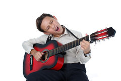 Guitar player performing very passionately on a white back Royalty Free Stock Images