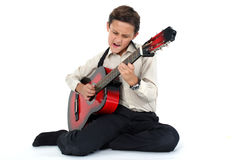 Guitar player performing very passionately on a white back Royalty Free Stock Image