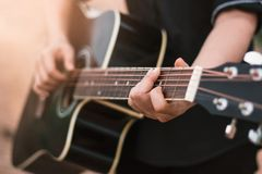Guitar player playing acoustic guitar, close up Stock Image