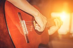 Guitar player playing song. Processing in vintage style Royalty Free Stock Photography