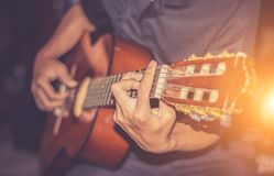 Guitar player playing song. Processing in vintage style Royalty Free Stock Photo