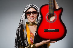 Guitar player with red Stock Image