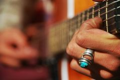 guitar player's hands and guitar stings Royalty Free Stock Photos