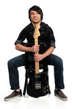 Guitar Player Sitting Royalty Free Stock Photography