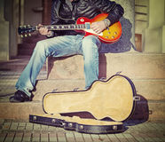 Guitar player on the stairs in vintage tone Stock Photo