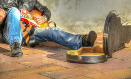 Guitar player in the street Royalty Free Stock Images