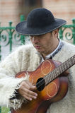 Guitar player in traditional Romanian costume Stock Photography
