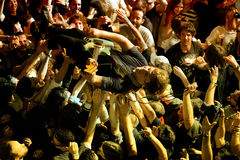 The guitar player of Ty Segall (band) performs above the spectators Royalty Free Stock Photo
