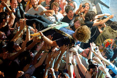 The guitar player of Ty Segall (band) performs above the spectators (crowd surfing or mosh pit) at Heineken Primavera Sound 2014 Stock Image