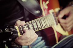 Guitar player in vintage tone Royalty Free Stock Photo