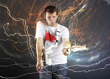 Guitar player with white electric guitar Stock Images
