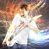 Guitar player with white electric guitar Royalty Free Stock Images