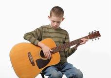 Guitar playing Royalty Free Stock Photos