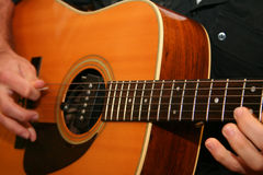 Guitar playing. Close up of young man playing classical guitar Royalty Free Stock Images