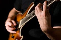 Guitar playing Stock Photography