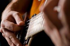Guitar playing Royalty Free Stock Photo