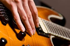 Guitar playing Royalty Free Stock Photography