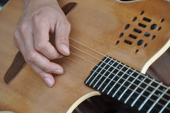 Guitar playing Stock Images