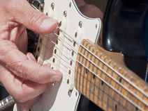 Guitar playing Royalty Free Stock Image