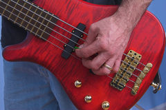 Guitar Playing. Electric bass guitar being played Stock Photo