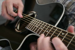 Guitar playing Stock Photos