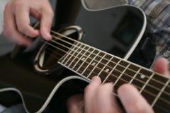 Guitar playing Stock Photos