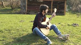 Guitar playing. Man playing music on a acoustic guitar. strings. stock video footage
