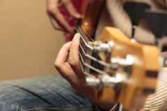 Guitar playing close-up Royalty Free Stock Photo