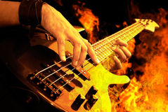 Guitar playing in fire Royalty Free Stock Images