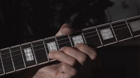 Guitar playing. Male hands with electric guitar. stock footage