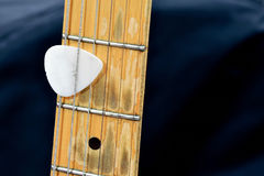 Guitar and plectron Royalty Free Stock Photos
