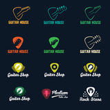 Guitar in plectrum shape logos set. Guitar shop  flat logos set. Guitar`s headstock in a plectrum shape Royalty Free Stock Photography