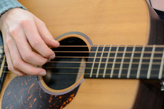 Guitar plucking - detail Royalty Free Stock Images