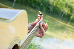 Guitar at the Pond Royalty Free Stock Photos