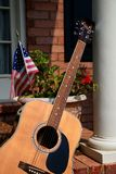 Guitar on Porch Royalty Free Stock Images